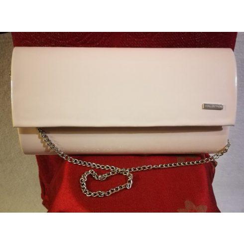 Patentos záródású, egy rekeszes, hosszú pánttal is használható, puder rózsaszín  színű, alkalmi kézi táska